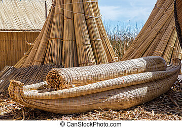 Reed boat on the manmade Uros floating islands on Lake Titicaca near Puno, Peru
