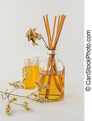 Reed Diffusers decorated with twigs and dried flowers.