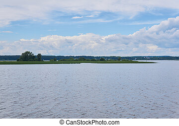 small reed island in the middle of a wide river