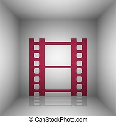 Reel of film sign. Bordo icon with shadow in the room.