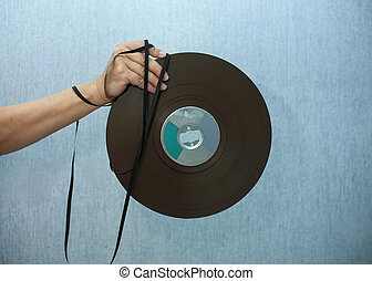 Reel To Reel Tape - Female hand holding a reel to reel tape ...