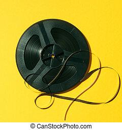 reel-to-reel tape on yellow background - reel-to-reel tape ...