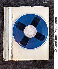 Reel to Reel Tape - Vintage Reel with a Tape on the Old Book...