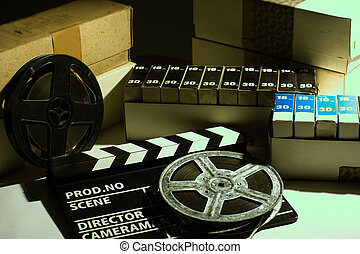 Reel with film and cinema clap. Old film in boxes