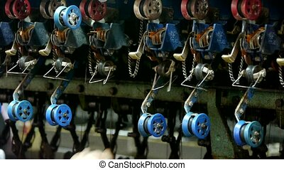 Reeling machine and Textile-machine in operation.Workers...