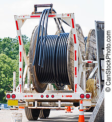 Reels of Cable on a Truck - Reels of black cable on a truck ...