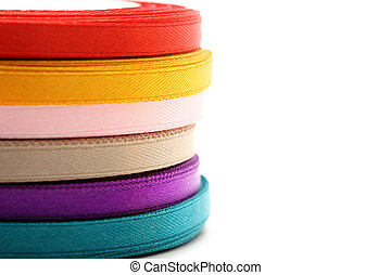 Reels of ribbon on the white background
