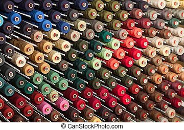 Reels with colorful threads - Background of the reels with...
