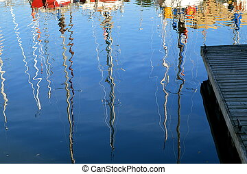 Refections of sailboats - The sailboat masts are reflected...
