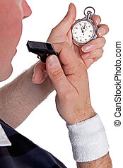 Referee checking stopwatch