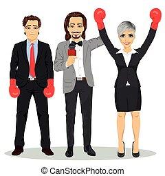referee holding winner businesswoman in boxer gloves, near standing sad loser businessman