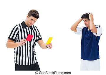 Referee showing yellow card to football player on white...