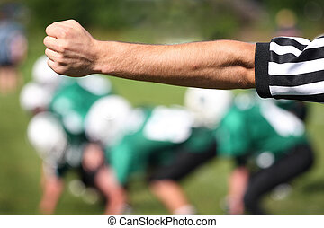 Referee signal - Referee's outstretched arm signals a play