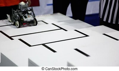 Referee watch toy robot climbs on stairs