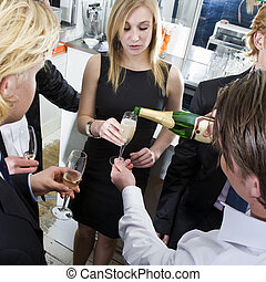 Refill - Waiter, refilling champagne glasses from the bottle...