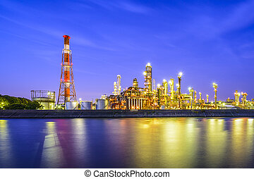 Refineries on a River - Oil refineries line a river in...
