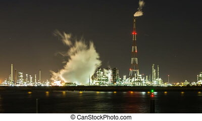 Refinery At Night Time Lapse - Timelapse sequence of a large...