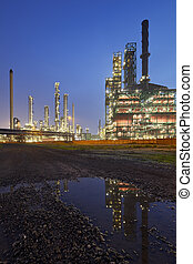 Refinery At Night With Reflection