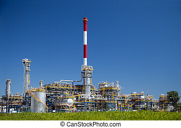 Refinery - Chemical and oil refinery against blue sky.