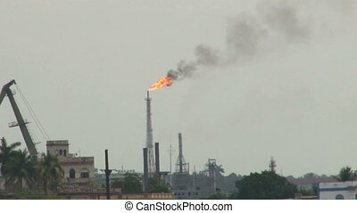 Refinery Chimney Fire Polution - View of oil refinery...