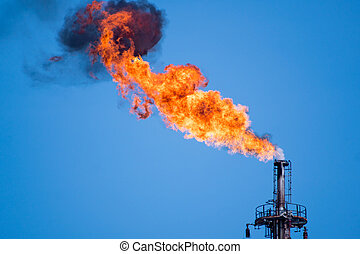 refinery fire gas torch - flaring of associated gas at oil...