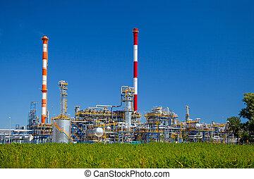 Refinery - Oil-refinery, industrial-plant under blue sky.