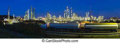 Refinery Panorama At Night - Panoramic view of a chemical...