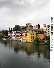 view from the bridge of Italian village Basano Del Grappa and beautiful reflection on the Brenta river