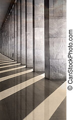 reflected columns - Row of columns with sunlight in the gaps...