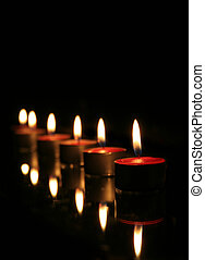 Reflected Lighted Candles