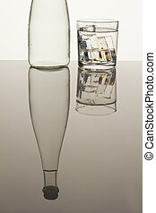 Reflecting bottle and glass cup.