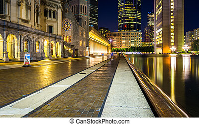 Reflecting pool and skyscrapers at night, seen at Christian Scie