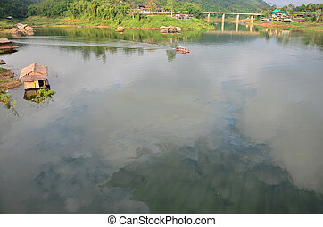 Reflection and Effects Environmental from Water contaminated with oil and This wastewater occur from people drain oil to natural water sources in Samprasob River in Kanchanaburi, Thailand.