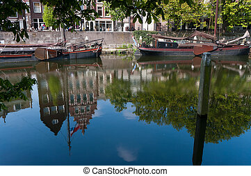 reflection in canal - reflection of authentic facades in a...