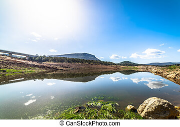 Reflection in Temo lake on a clear day