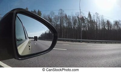 Reflection in the car mirror while driving timelapse video