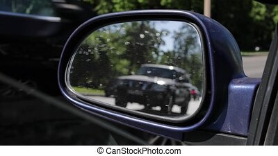 reflection in the car through a side view mirror