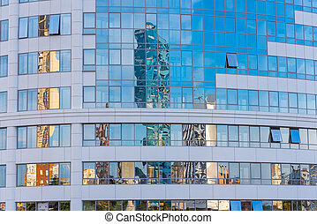 Reflection in the mirror facade of a multi-storey building