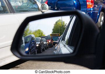 reflection in the mirror of a car, congestion