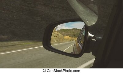 Reflection in the mirror of a mountain road serpentine