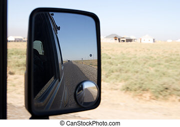 reflection in the mirror of the road car