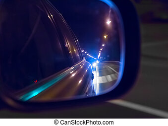 reflection in the mirror riding cars night