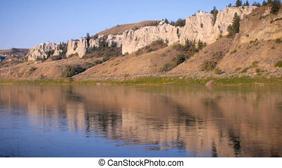 Reflection in the Missouri River revealing the white cliffs...