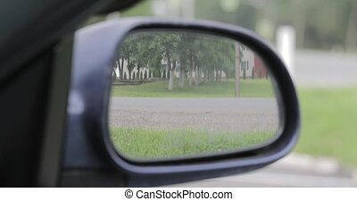 reflection in the side mirror