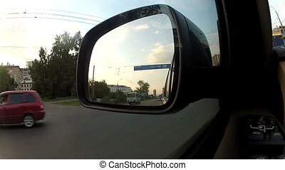 Reflection in the side view mirror of the car