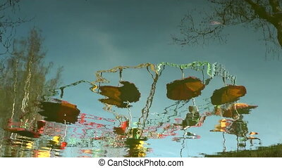 Reflection merry-go-round in the river