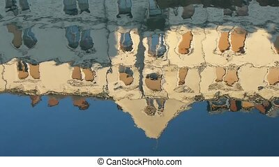 Reflection of a building in water