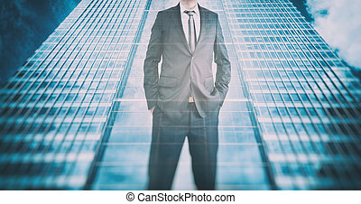 Reflection of a businessman in modern skyscraper. Business leader, career growth