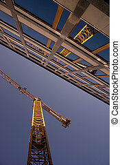 reflection of a crane in an office building