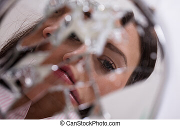 Woman's Face In Broken Mirror - Reflection Of A Woman's Face...